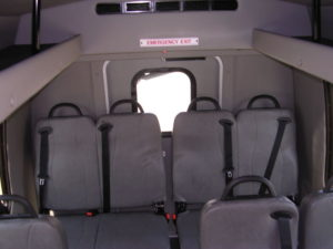 Interior of bus shown with all seating up.