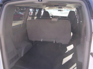 Inside of the rear of a fleet 8 passenger van.