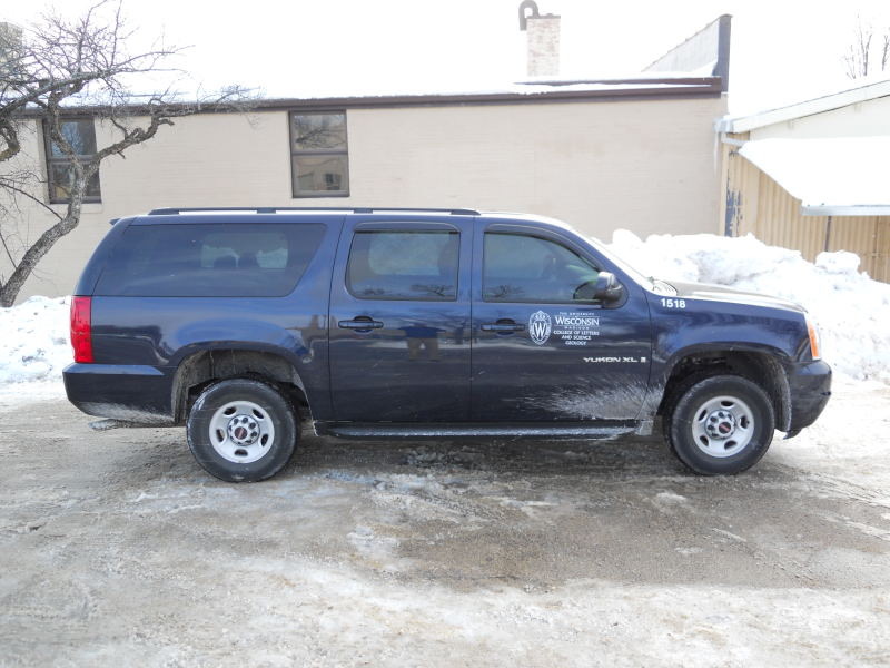 Image of a large SUV with UW decals.