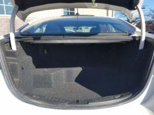 Image of the inside of the white fleet car's truck.